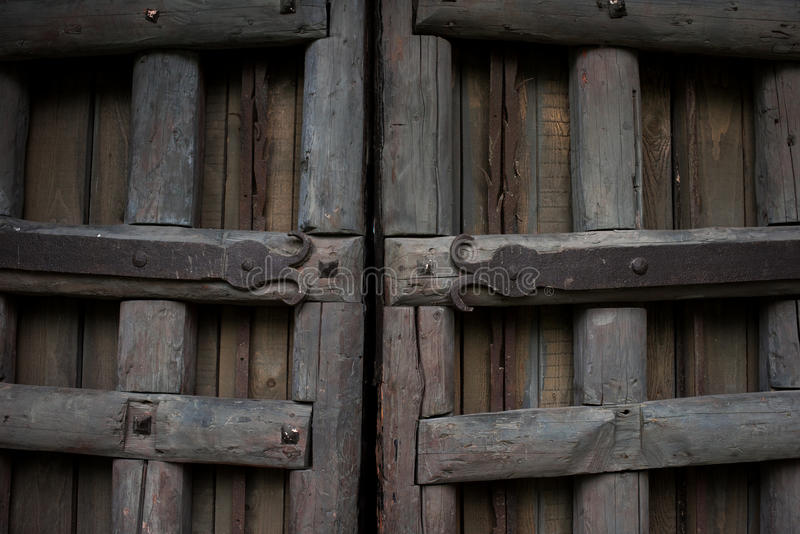 Ancient wooden gate with metal ornaments stock photos