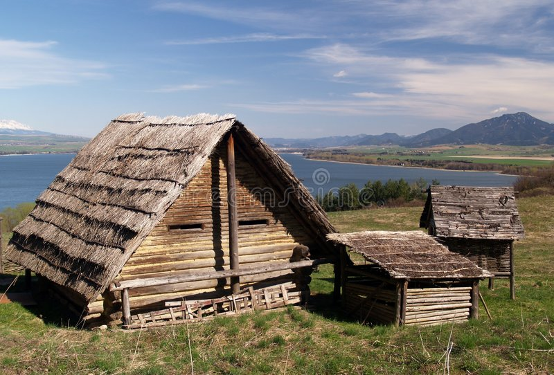 Ancient wooden houses. In the outdoor archeological museum of Celtic culture located in Havranok near Liptovska Mara lake in Slovakia royalty free stock images