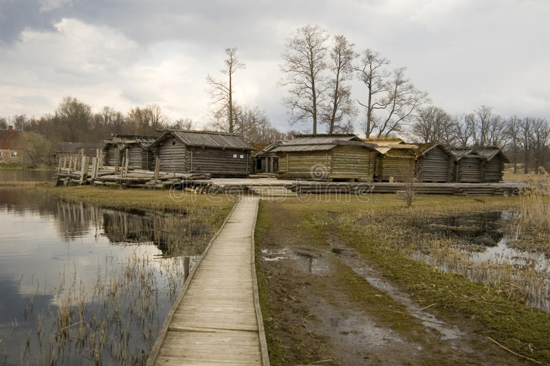 Ancient wooden houses in Latvia royalty free stock image