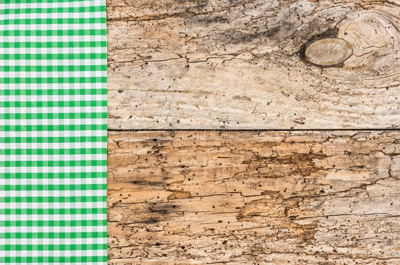 Ancient wooden kitchen table with vintage green tablecloth. Wooden table background rustic texture, with green checkered tablecloth, high angel view stock photos