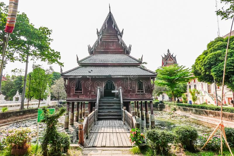 Ancient wooden monastery and The library on stilts in Wat Thung Si Muang temple in Ubon Ratchathani ,Thailand. Ancient wooden monastery and The library on stilts stock photo