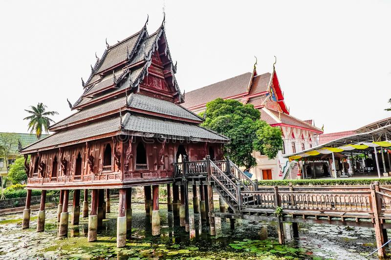 Ancient wooden monastery and The library on stilts in Wat Thung Si Muang temple in Ubon Ratchathani ,Thailand. Ancient wooden monastery and The library on stilts royalty free stock photo