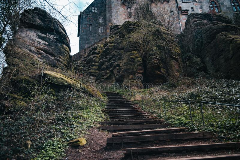 Ancient wooden stairs, mountain stairway. With big rocks background royalty free stock photography