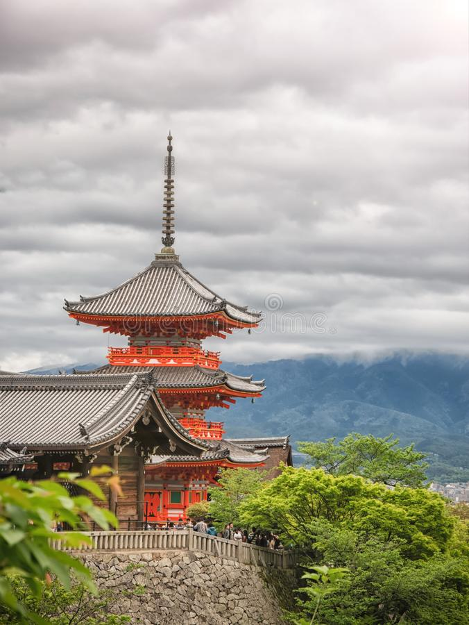 Ancient wooden temple with spring foliage colors at the mountain of Arashiyama, Kyoto, Japan royalty free stock photo