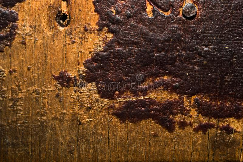 Ancient wooden texture with pieces of varnish coating close royalty free stock images