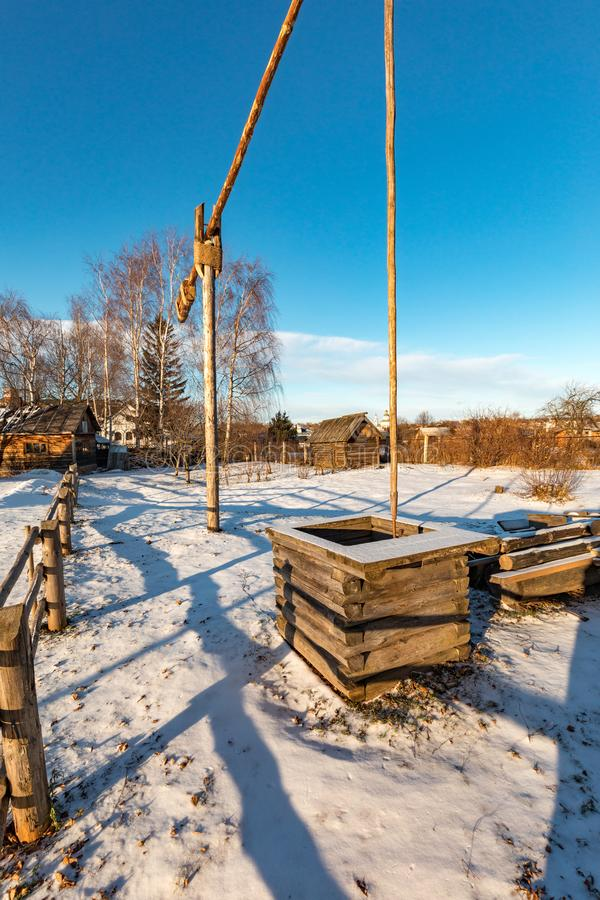 An ancient wooden well in Suzdal in winter. stock image