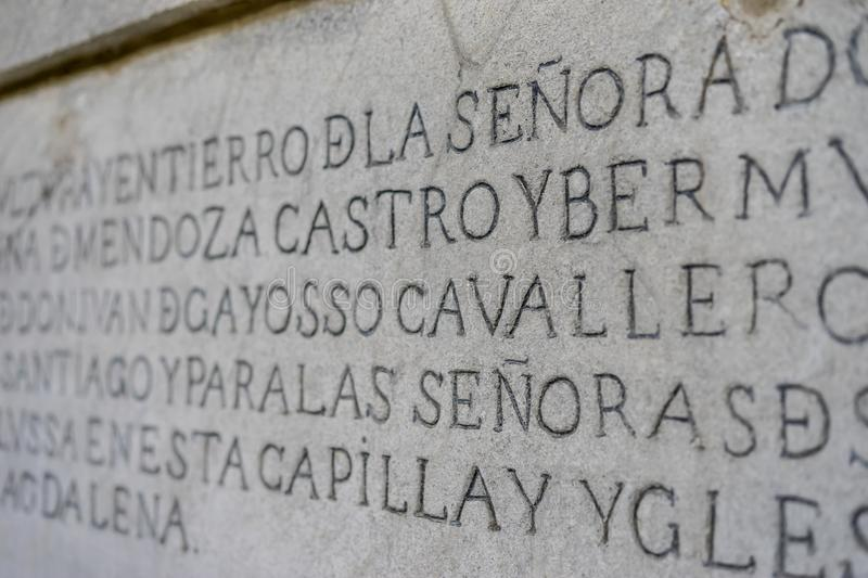 ancient writing in latin and ancient spanish carved on the stone royalty free stock photo