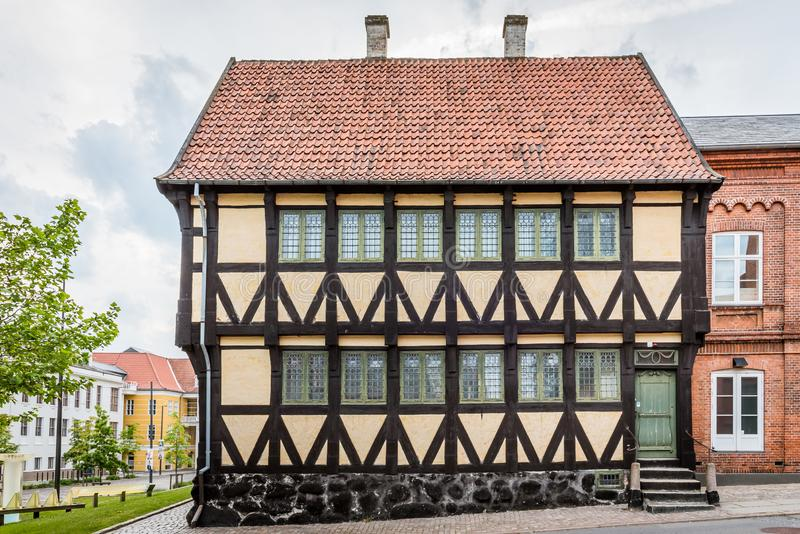 An ancient yellow half-timbered house in the old quarters of Svendborg. Denmark, July 10, 2019 stock photos