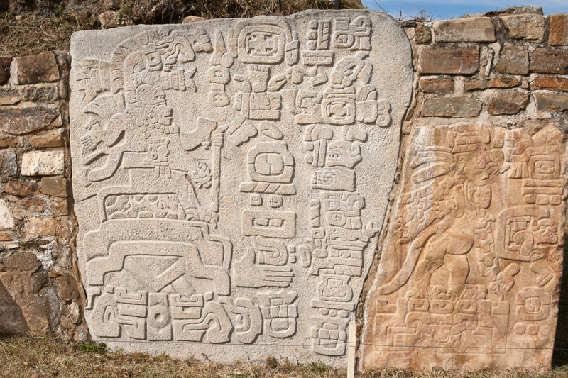 Ancient zapotec relief on the wall stock photos