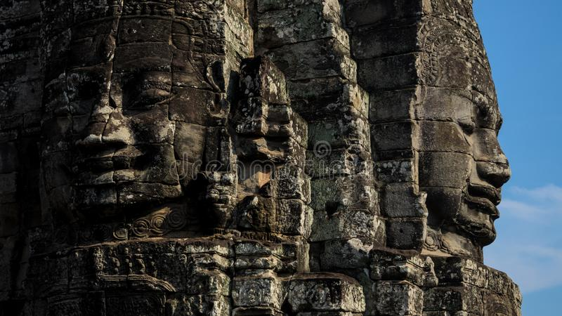 Ancients faces stone temple in ruins stock photos