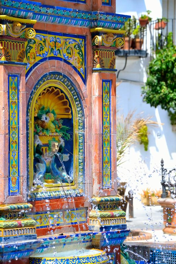 Andalusian fountain. Fountain made with colorful tiles from Seville. Mudéjar-style with motifs to fauna and flora, located on the main square in Vejer de la royalty free stock photography
