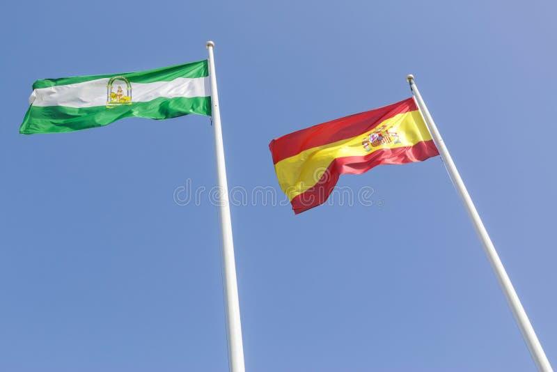 Andalusian- och spanjorflagga arkivfoto
