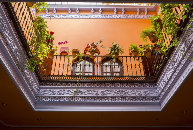 Andalusian style roofed courtyard, Seville, Spain stock photography