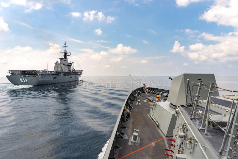HTMS Bhumibol Adulyadej Guided missile stealth frigate approachs to HTMS Chakri Naruebet stock photography