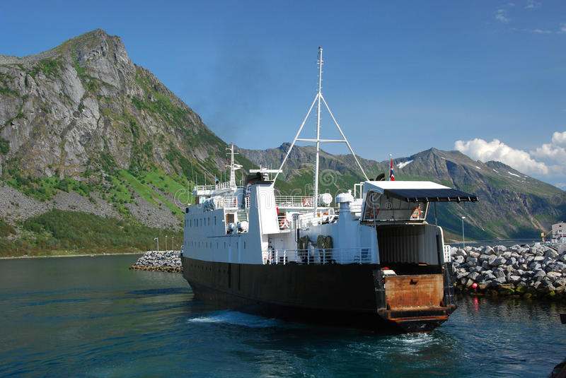 Norway - Car Ferry Andenes-Gryllefjord with open tailgate. Andenes-Gryllefjord Car Ferry with open tailgate by port of arrival Gryllefjord Norway with mountains stock images