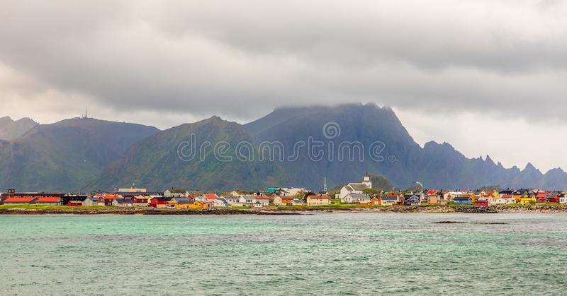 Andenes village panorama with multiple houses and mountains in the background, Lofoten islands, Andoy Municipality, Vesteralen stock images