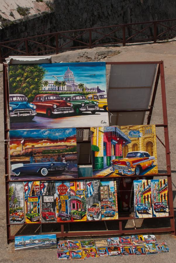 Andenken von Kuba Kubanische Malereien mit Autos und Häusern lizenzfreie stockbilder