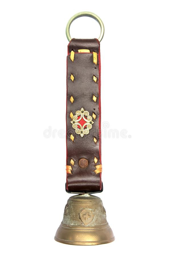 Andenkenglocke von der Schweiz lokalisierte auf weißem Hintergrund Alte Glocke von Schweizer lokalisiert stockbild