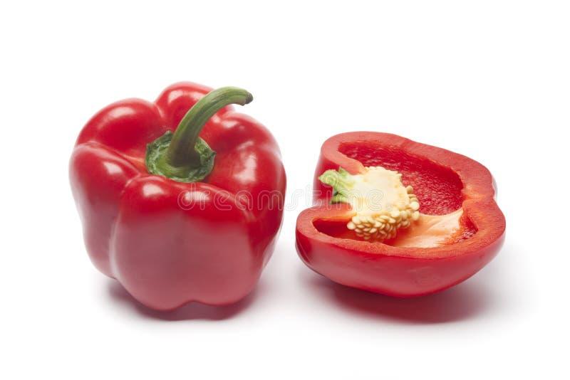 Anderhalf rode groene paprika stock fotografie