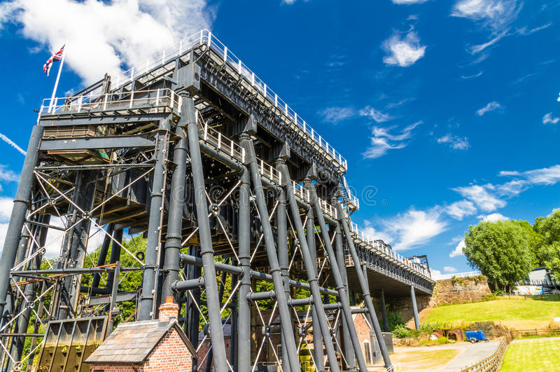 Anderton Boat Lift, canal escalator. The Anderton Boat Lift, which raises narrowboats between River Weaver the Trent and Mersey Canal. England, United Kingdom stock image
