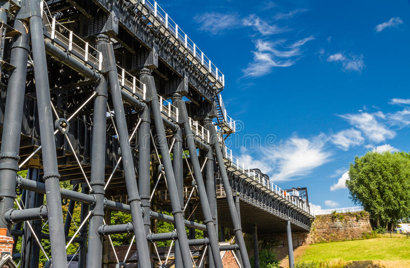 Anderton Boat Lift, canal escalator. The Anderton Boat Lift, which raises narrowboats between River Weaver the Trent and Mersey Canal. England, United Kingdom royalty free stock image