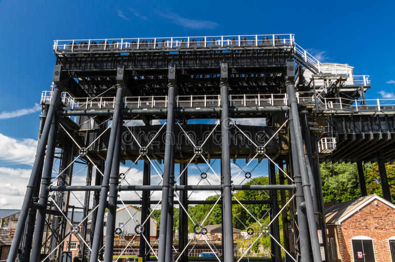 Anderton Boat Lift, canal escalator. The Anderton Boat Lift, which raises narrowboats between River Weaver the Trent and Mersey Canal. England, United Kingdom royalty free stock photography