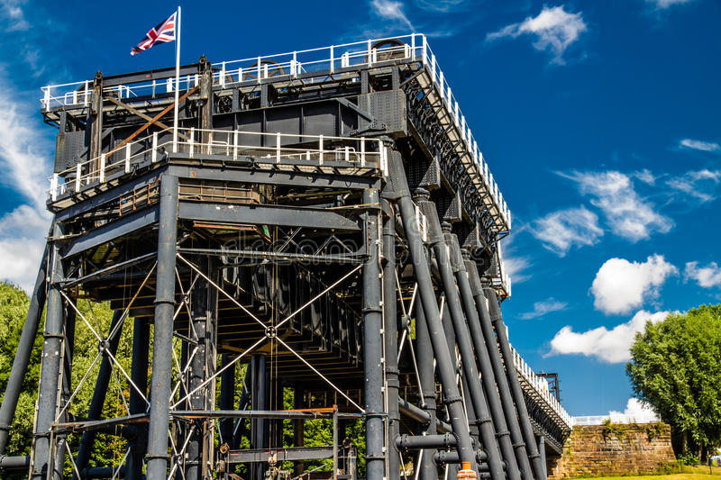 Anderton Boat Lift, canal escalator. The Anderton Boat Lift, which raises narrowboats between River Weaver the Trent and Mersey Canal. England, United Kingdom royalty free stock photo