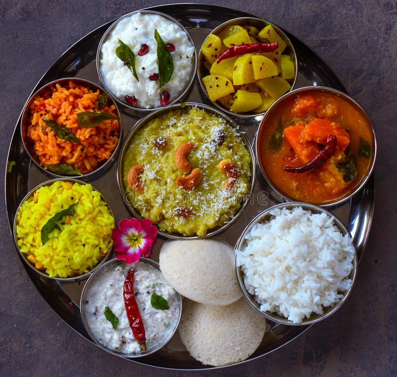 Andhra thaali meals traditional south Indian platter. South Indian thaali buffet meals consisting of rice,potato curry,tomato rice lemon rice,sweet shakkar stock photography
