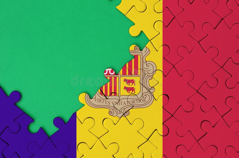 Andorra flag is depicted on a completed jigsaw puzzle with free green copy space on the left side vector illustration