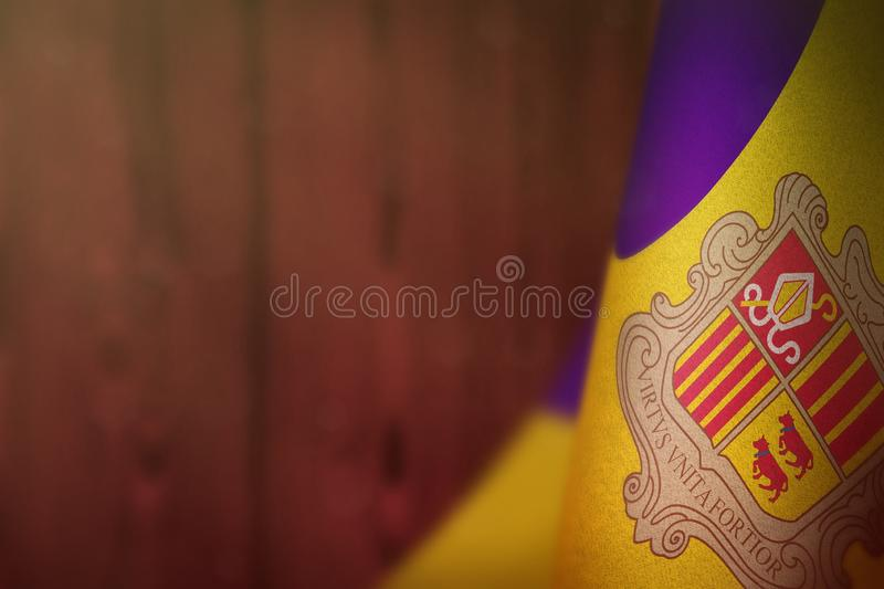 Andorra flag for honour of veterans day or memorial day. Glory to the Andorra heroes of war concept on red blurred natural wood. Andorra hanging flag for honour royalty free stock photos