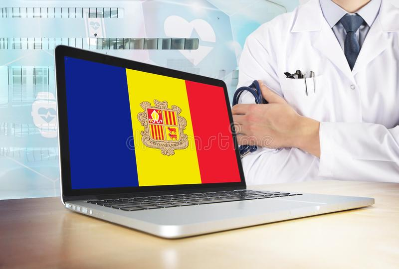Andorra healthcare system in tech theme. Andorran flag on computer screen. Doctor standing with stethoscope in hospital. Cryptocurrency and Blockchain concept stock photos