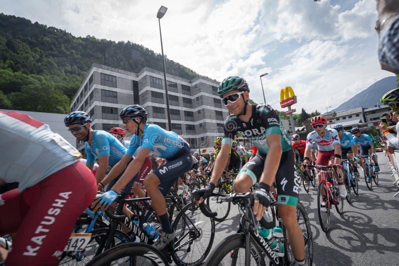 Andorra la Vella, Andorra. September 2019: Cyclists of the Vuelta de Espana just after the beginning of the race. Andorra la Vella, Andorra. September 2019 royalty free stock photography