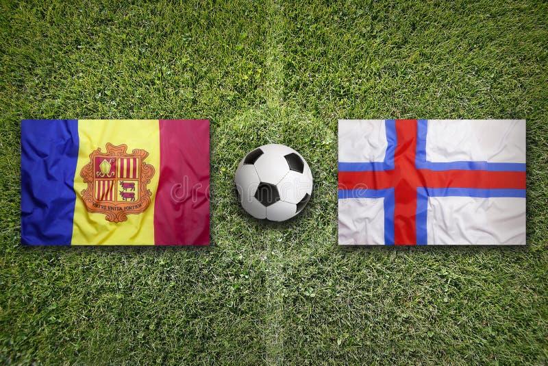 Andorra versus De vlaggen van de Faeröer op voetbalgebied stock afbeeldingen