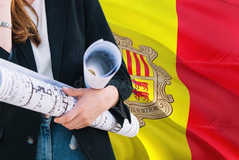Andorran architekt kobiety mienia projekt przeciw Andorra falowania flagi tłu Budowy i architektury poj?cie zdjęcie stock
