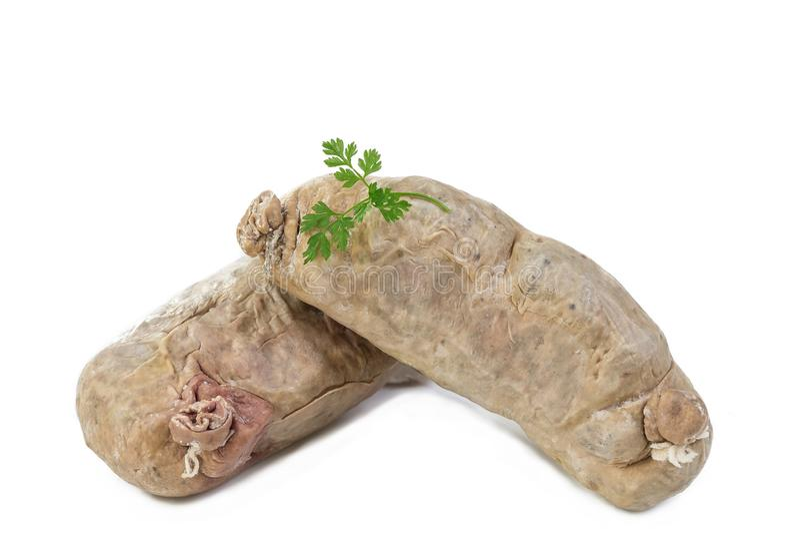 Andouillette: Franse typische worst van varkensvleesdarm op een witte achtergrond royalty-vrije stock fotografie