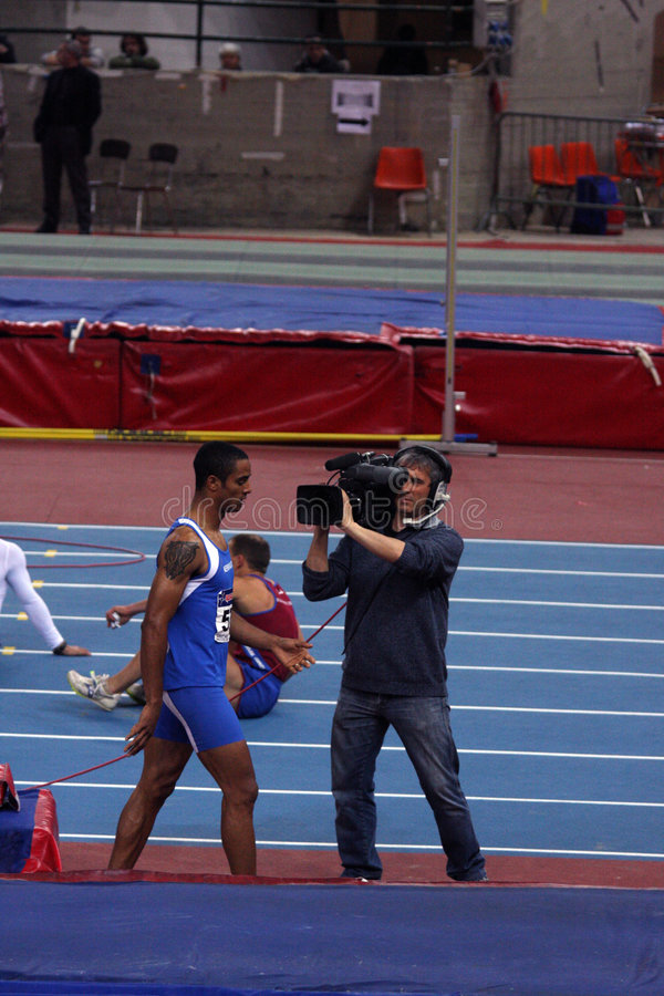 Andrew Howe hervatte van de televisiecamera stock fotografie