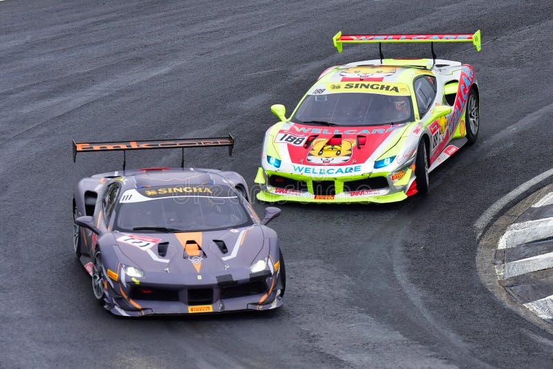 Andrew Moon, der Tiger Wu an Ferrari-Herausforderungs-Asia Pacific-Reihe läuft, laufen lizenzfreie stockbilder