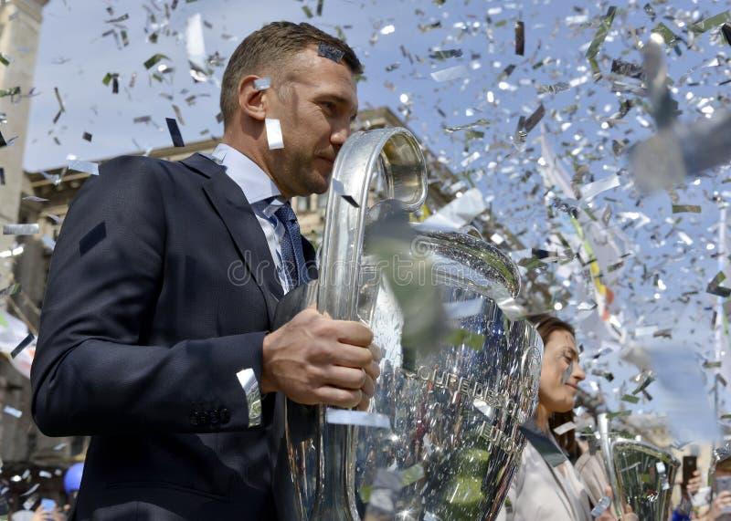Andriy Shevchenko and Iya Andrushchak with the cups of the men`s and women`s UEFA Champions League. Kyiv / Ukraine - 21 April, 2018: Andriy Shevchenko and Iya royalty free stock image