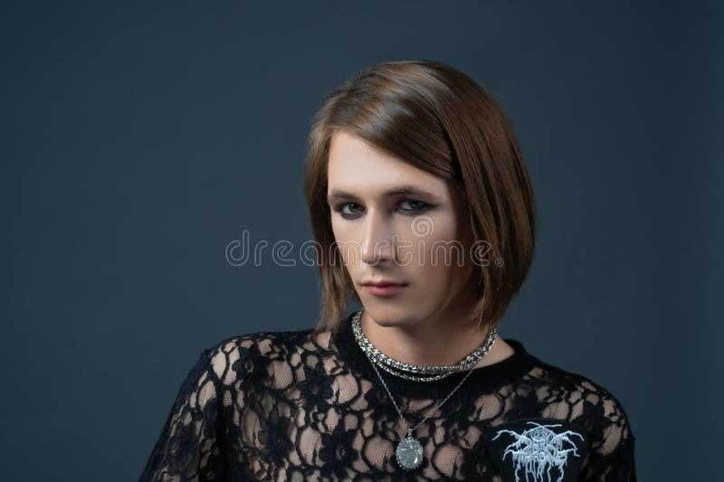 Androgynous beautiful young man on dark background. Model tests. stock image