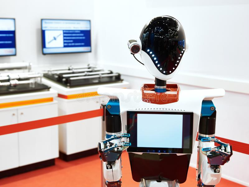 Android robot to work at exhibition stock photo