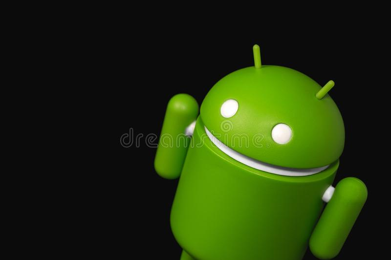 Android symbol figure on the black background. Android is the o. Perating system for smart phones, tablet computers, e-books, game consoles, and other devices royalty free stock photo