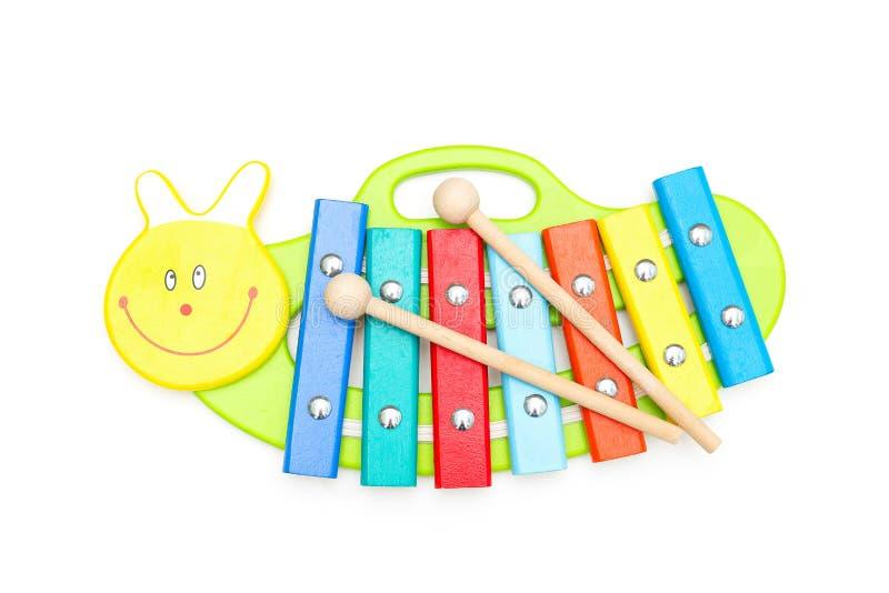 Andwooden de kind houten xylofoon stokken op een witte achtergrond e royalty-vrije stock foto