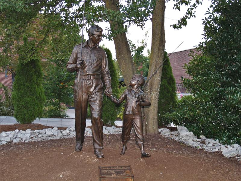 Andy and Opie Taylor. A statue of Andy and Opie Taylor stands in front of the Andy Griffith Playhouse in Mt. Airy, North Carolina, Andy Griffith`s childhood home stock images