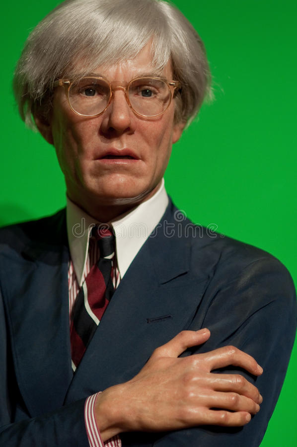 Andy Warhol. Portrait of Andy Warhol on green backgroud. wax figure at Madame Tussauds in New York royalty free stock images