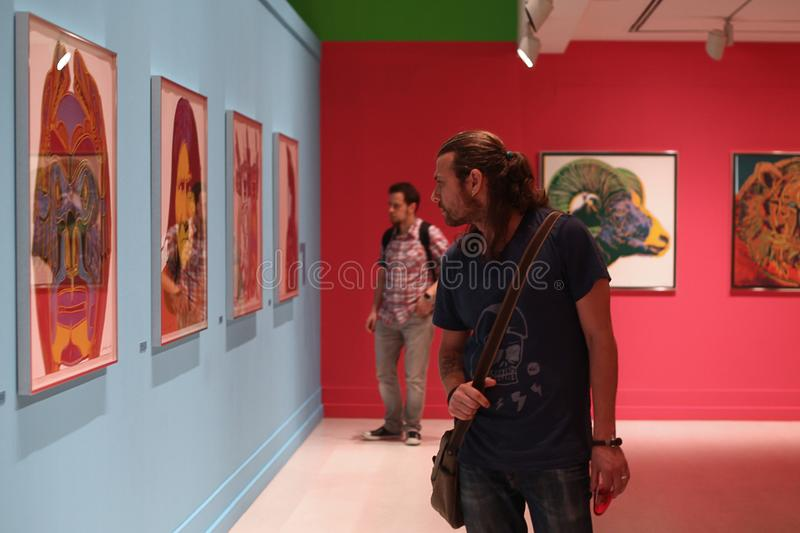 Young Men in Painting Exhibition - Andy Warhol/Istanbul. Andy Warhol exhibition in Ä°stanbul-Turkey at Pera Museum stock photos