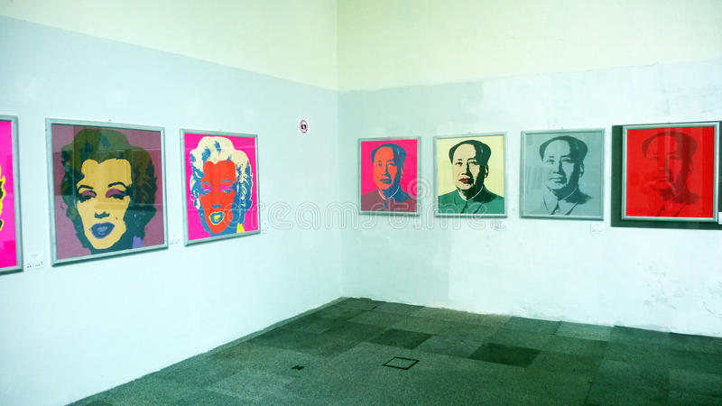 Andy warhol. The famous paintings of mao zedong and marilyn monroe of the artist andy warhol in exhibition at naples in italy royalty free stock images