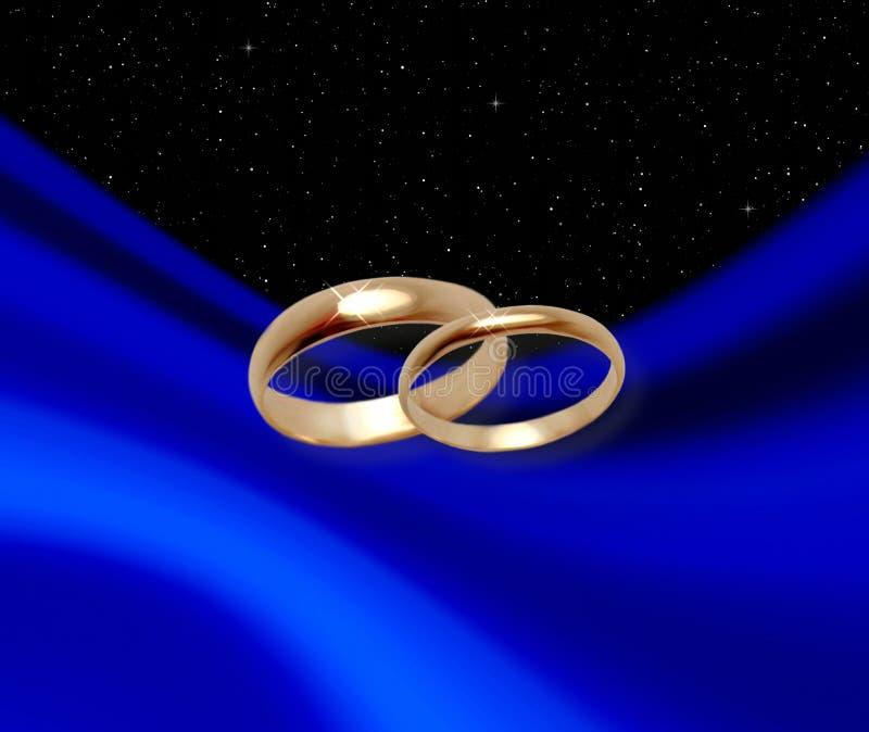 Anelli di cerimonia nuziale sul drapery blu illustrazione di stock