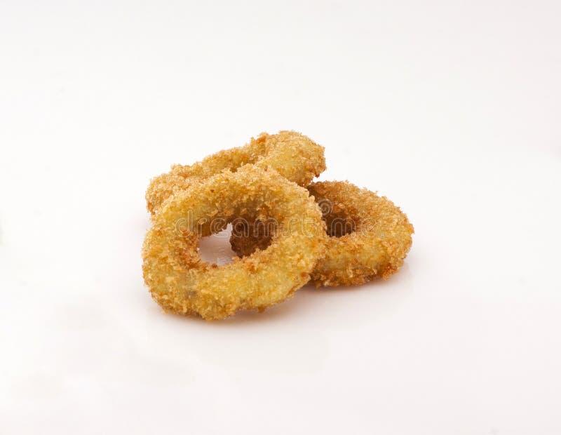 Anelli di cipolla fritti in pasta fotografie stock libere da diritti