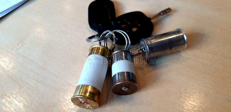 Anelli portachiavi della cartuccia del fucile da caccia immagini stock libere da diritti