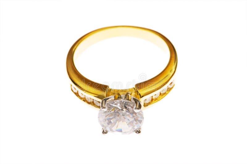 Anello dorato con il diamante immagine stock